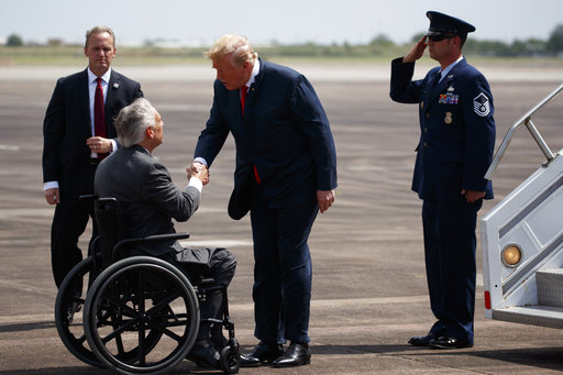 Texas Gov. Greg Abbott greets President Donald Trump after arriving at Ellington Field Joint Reserve Base, Thursday, May 31, 2018, in Houston.