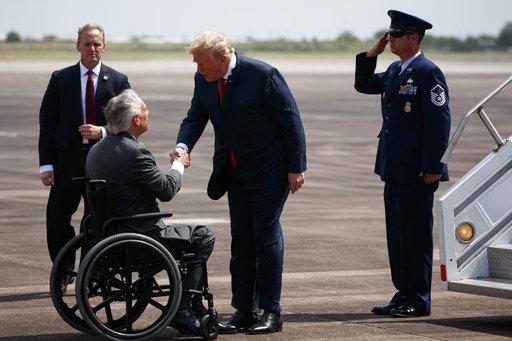 Texas Gov. Greg Abbott greets President Donald Trump after arriving at Ellington Field Joint Reserve Base, Thursday, May 31, 2018, in Houston.