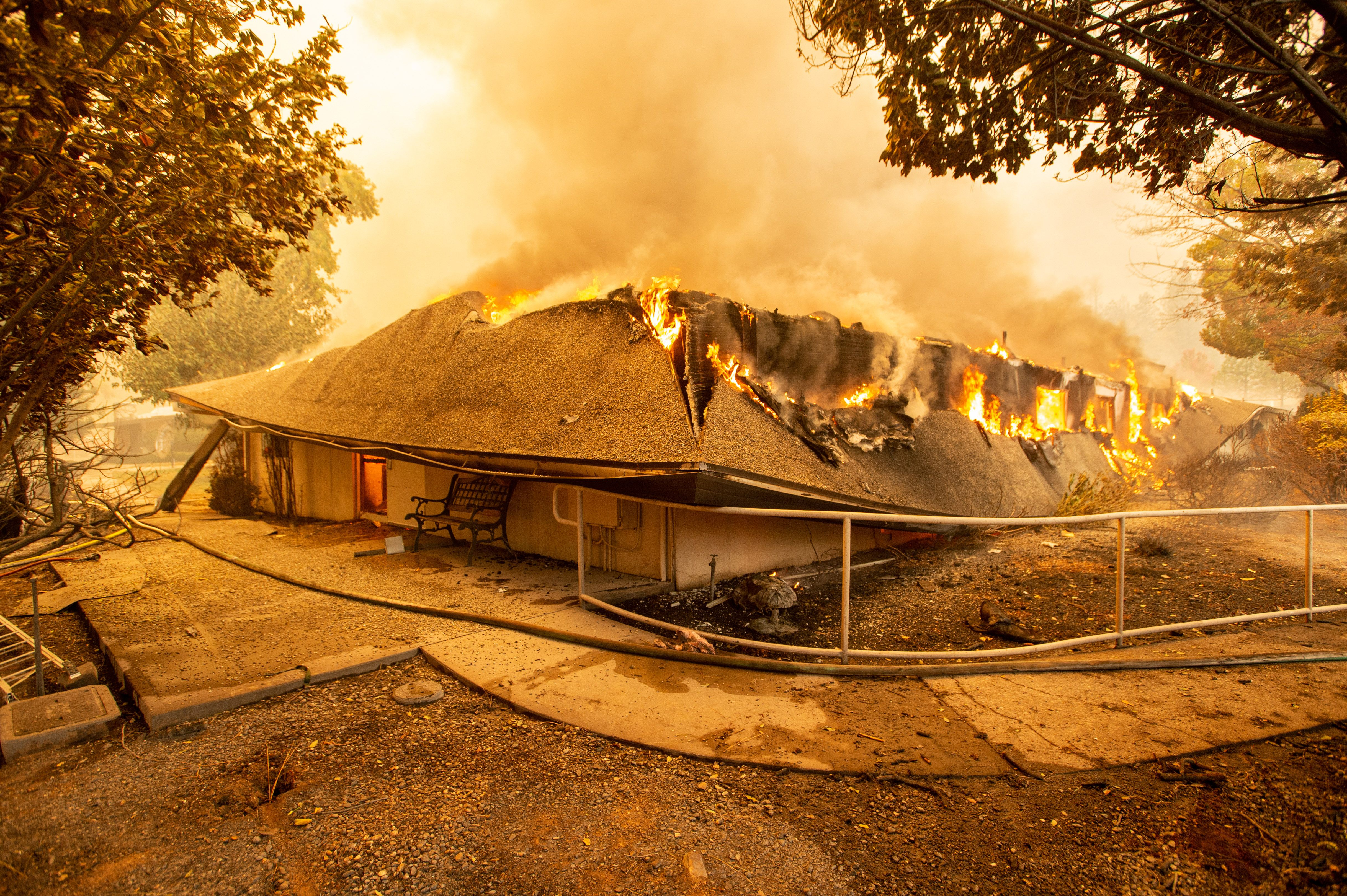 The Feather River Hospital burns down during the Camp fire in Paradise, California on November 8, 2018.