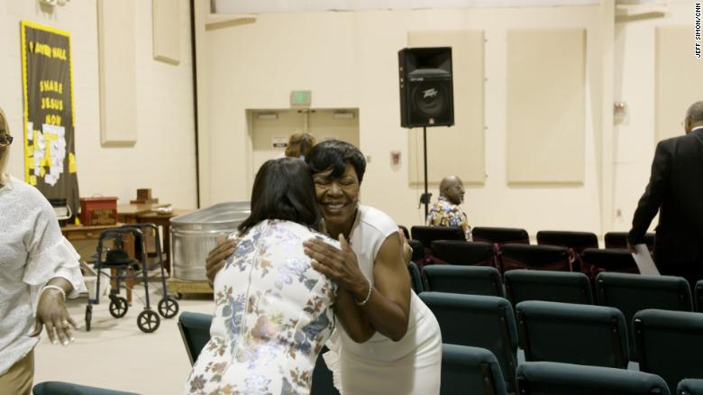 Jameria Moore, who is running for probate judge, hugs a woman in Hopewell Baptist Church in Birmingham, Alabama on Sunday, June 3.