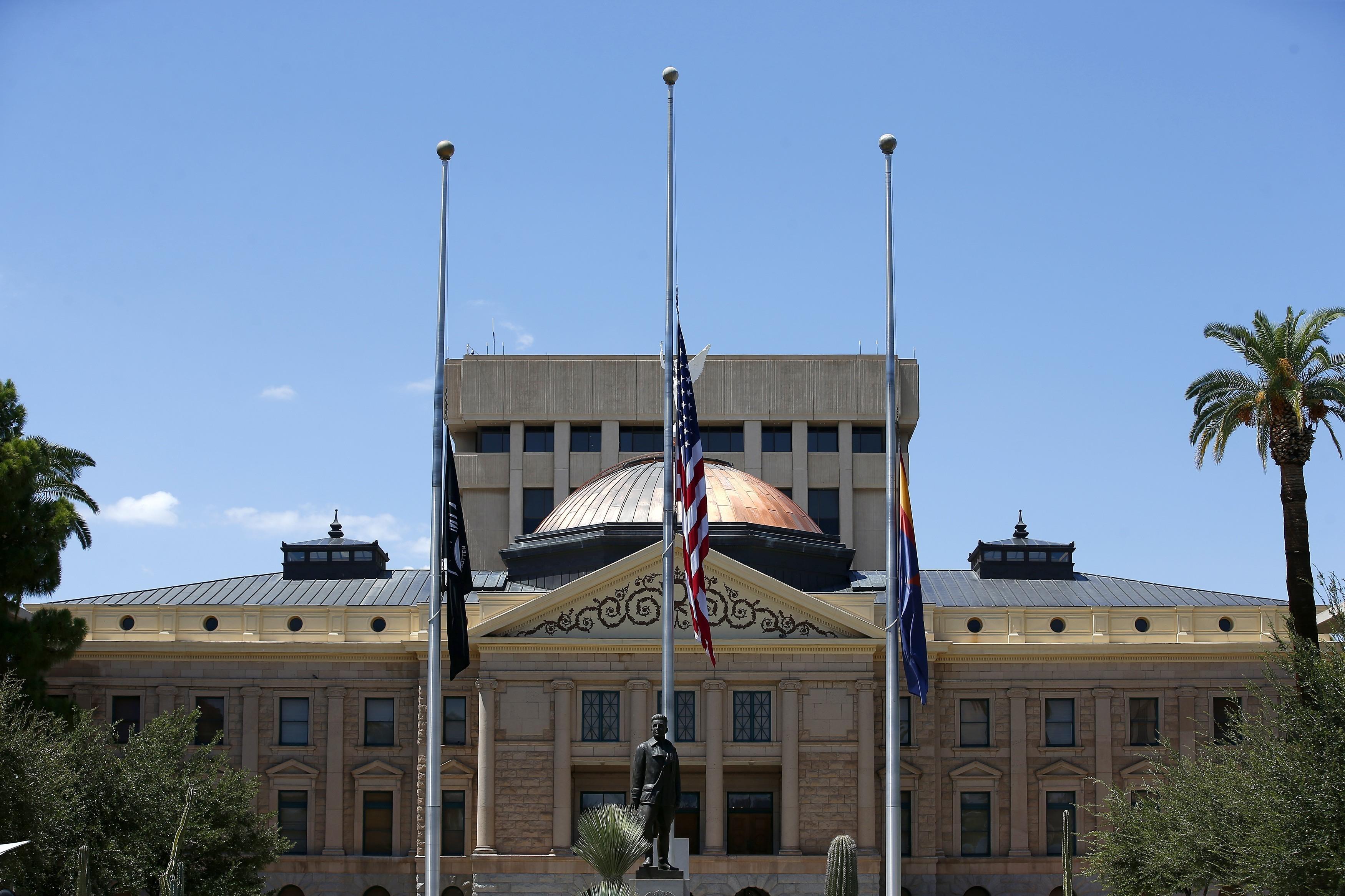 Flags fly at half-staff at the Arizona Capitol in memory of Sen. John McCain on Sunday.