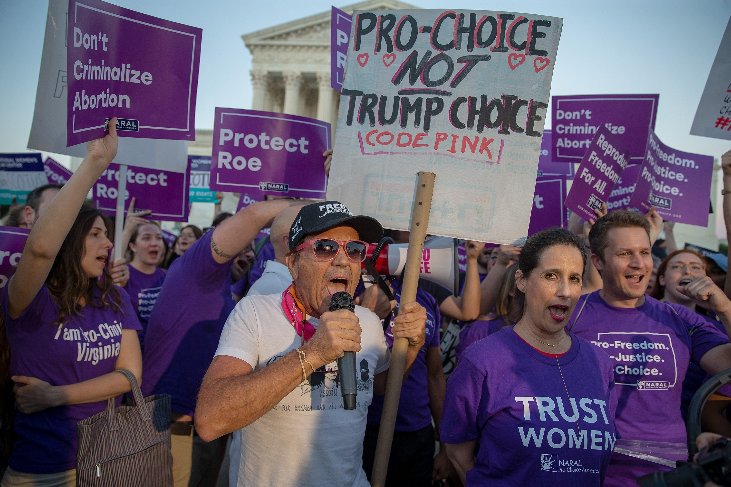 Pro-choice and anti-abortion protesters demonstrate in front of the US Supreme Court on Monday