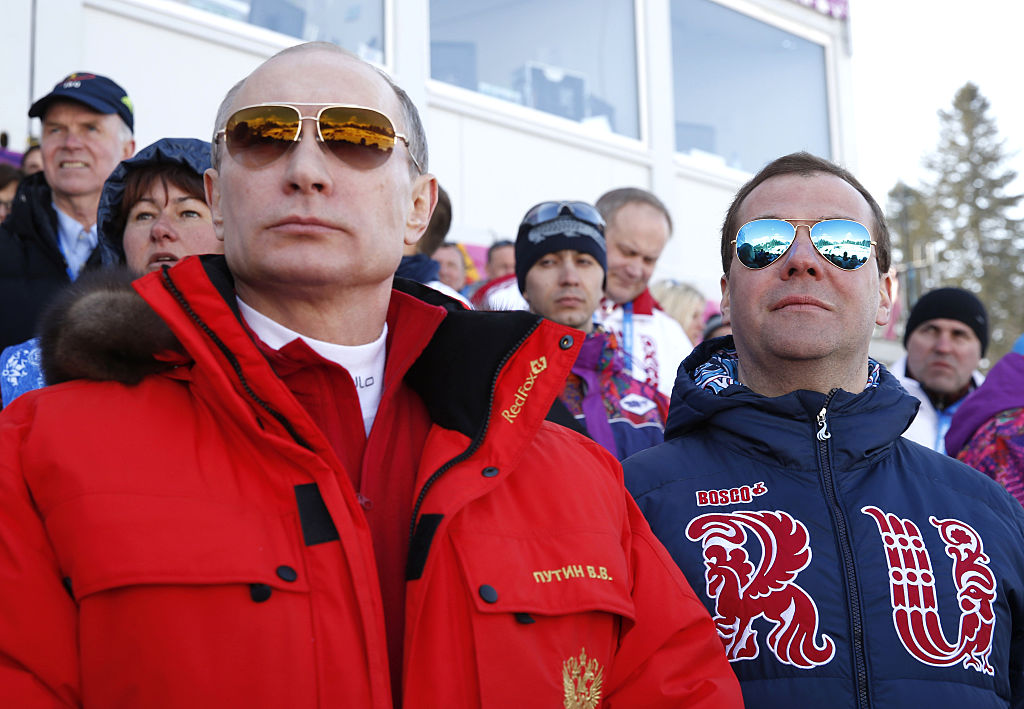 Russia's President Vladimir Putin and Prime Minister Dmitry Medvedev watch the men's cross-country 4 x 10 km relay event at the 2014 Sochi Winter Olympics.