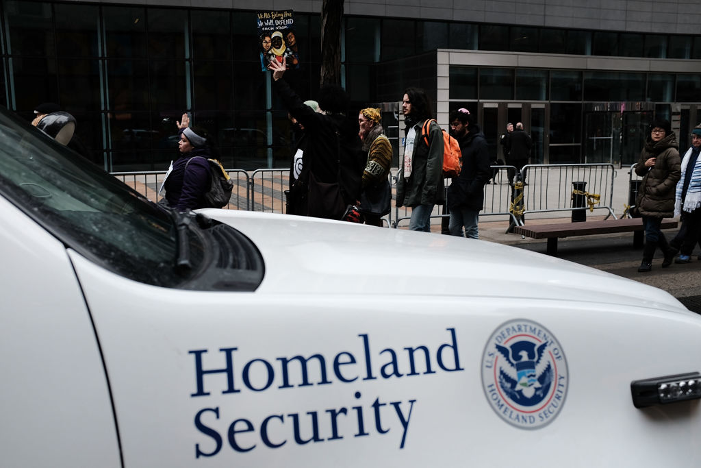 In this Jan. 11, 2018 photo, a Homeland Security vehicle can be seen outside a federal building in New York City during a protest.