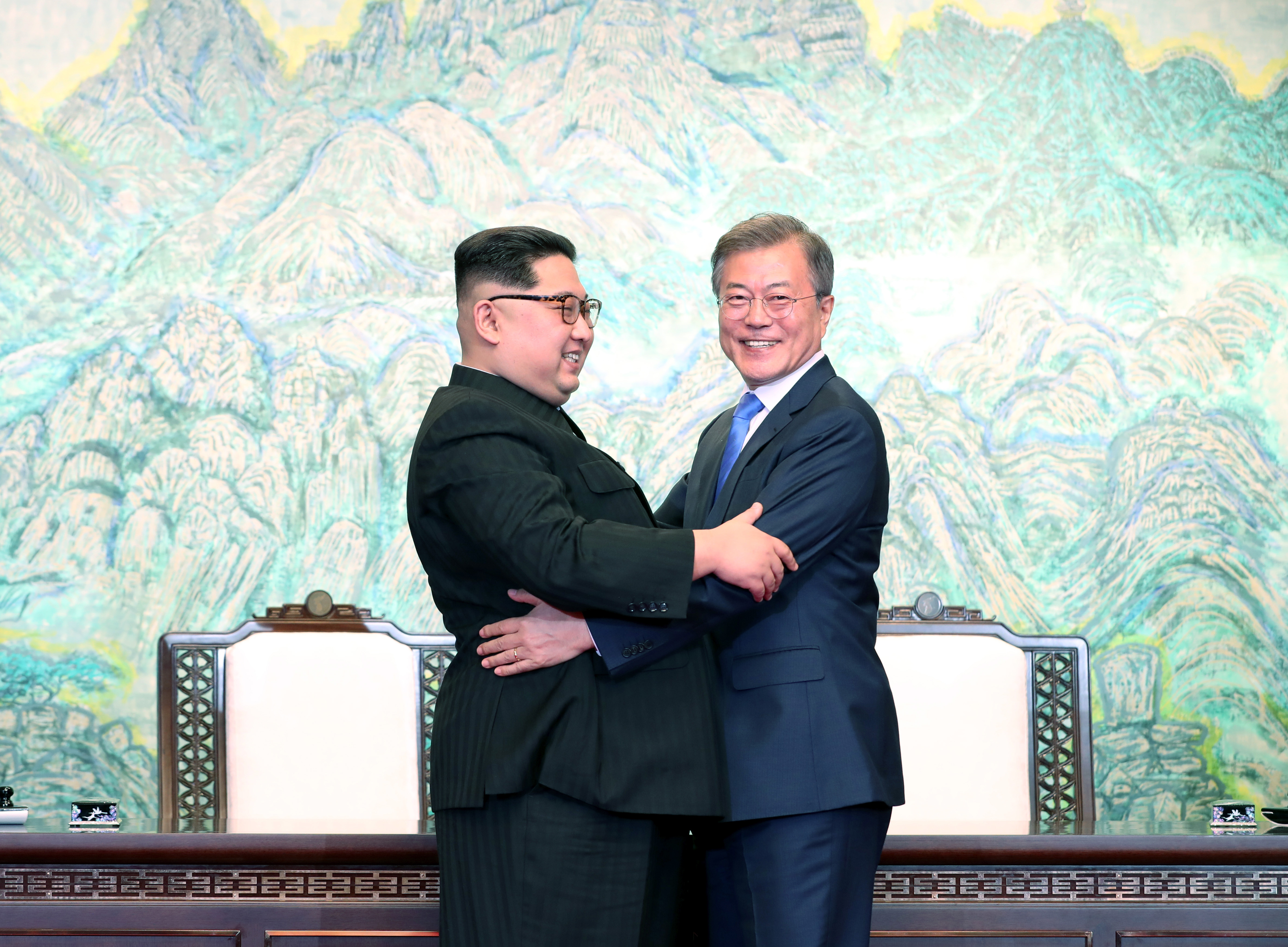 North Korean leader Kim Jong Un and South Korean President Moon Jae-in embrace after signing the Panmunjom Declaration for Peace, Prosperity and Unification of the Korean Peninsula during the Inter-Korean Summit.