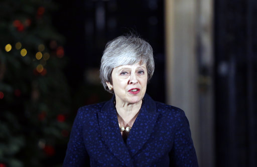 Britain's Prime Minister Theresa May delivers a speech outside 10 Downing Street in London, Wednesday, Dec. 12, 2018.