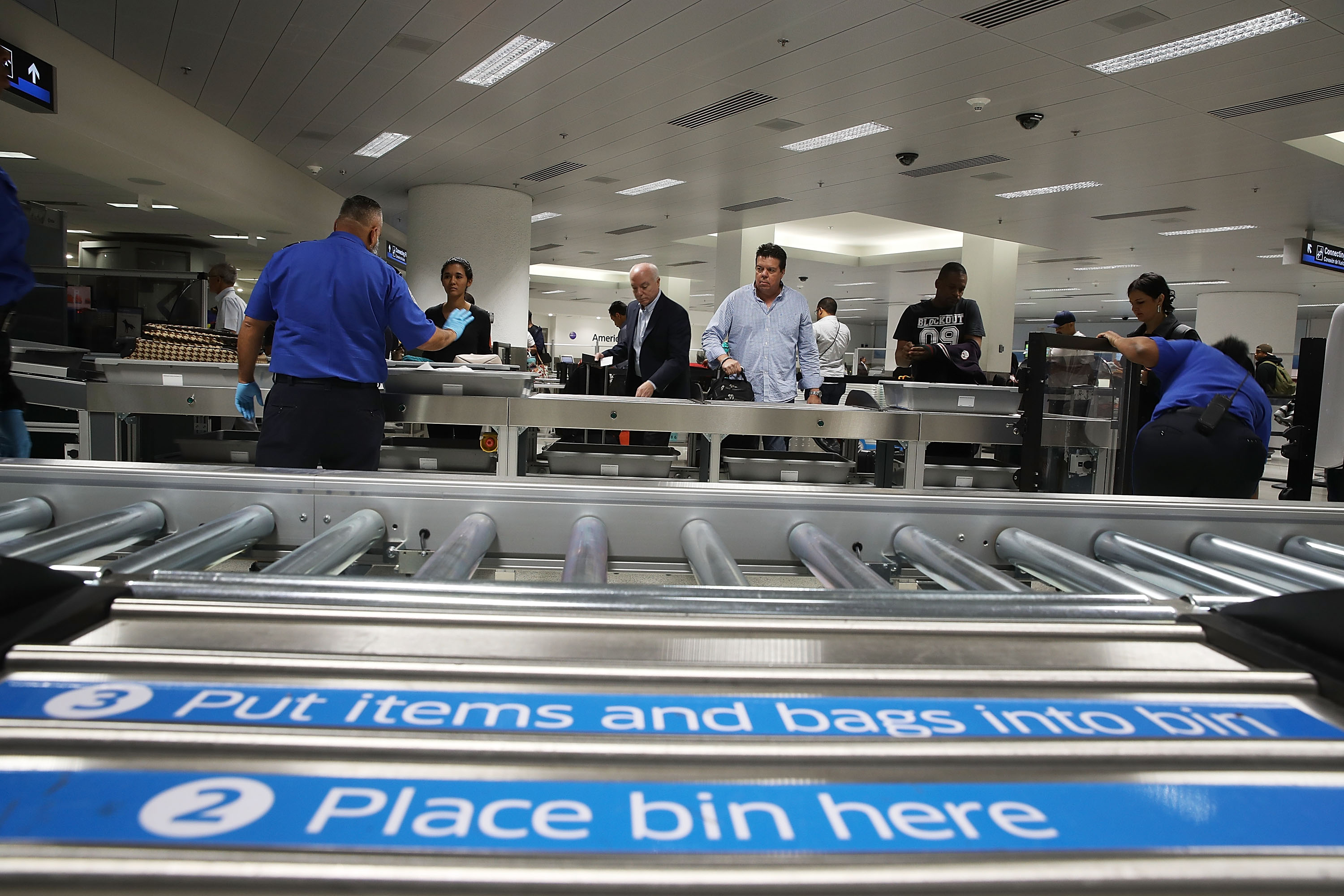 Travelers pass through Transportation Security Administration screening at Miami International Airport in October.