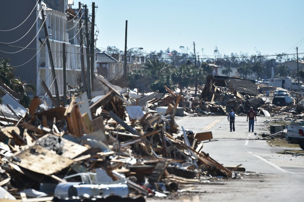 Rescue teams used dogs to search for victims of Hurricane Michael on Friday in Mexico Beach, Florida.