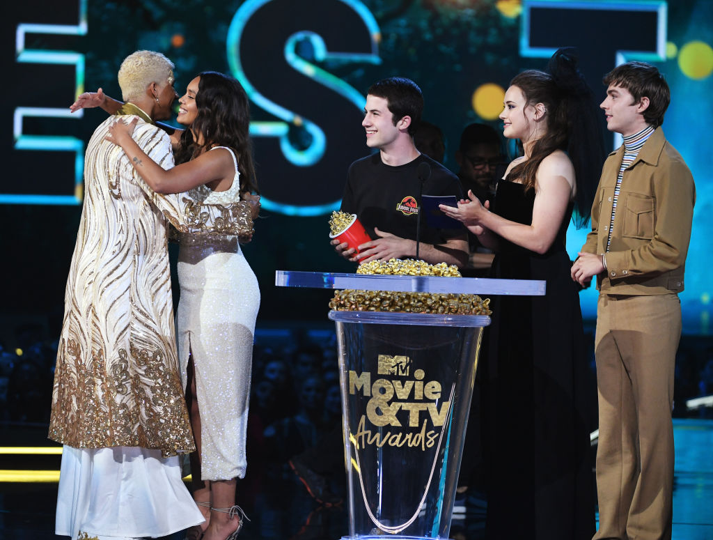 Actor Keiynan Lonsdale accepts the Best Kiss award for 'Love, Simon' from actors Alisha Boe, Dylan Minnette, Katherine Langford, and Miles Heizer onstage during the 2018 MTV Movie And TV Awards.
