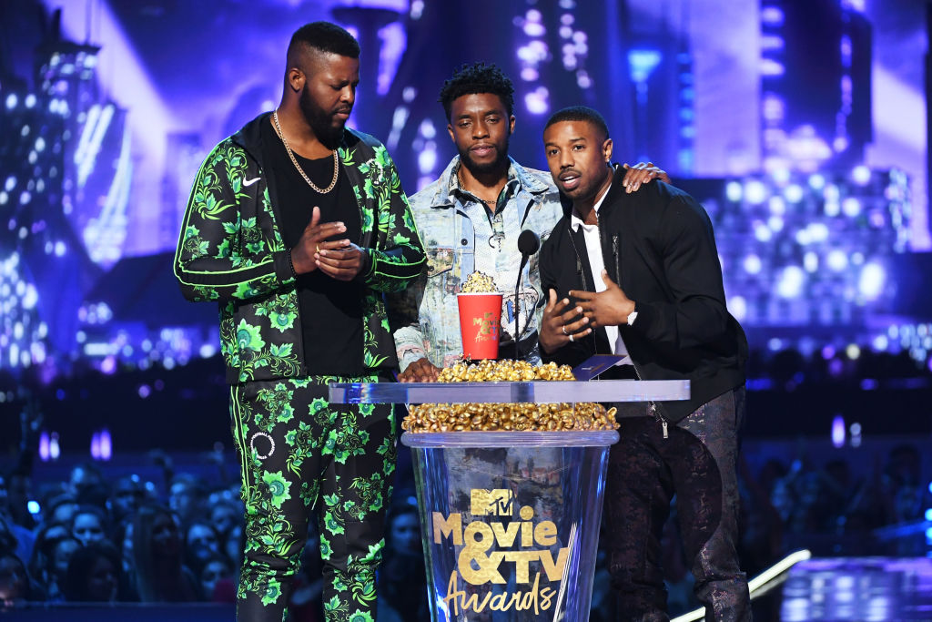 Actors Winston Duke, Chadwick Boseman, and Michael B. Jordan accept the Best Movie award (Presented by Toyota) for 'Black Panther' onstage during the 2018 MTV Movie And TV Awards.