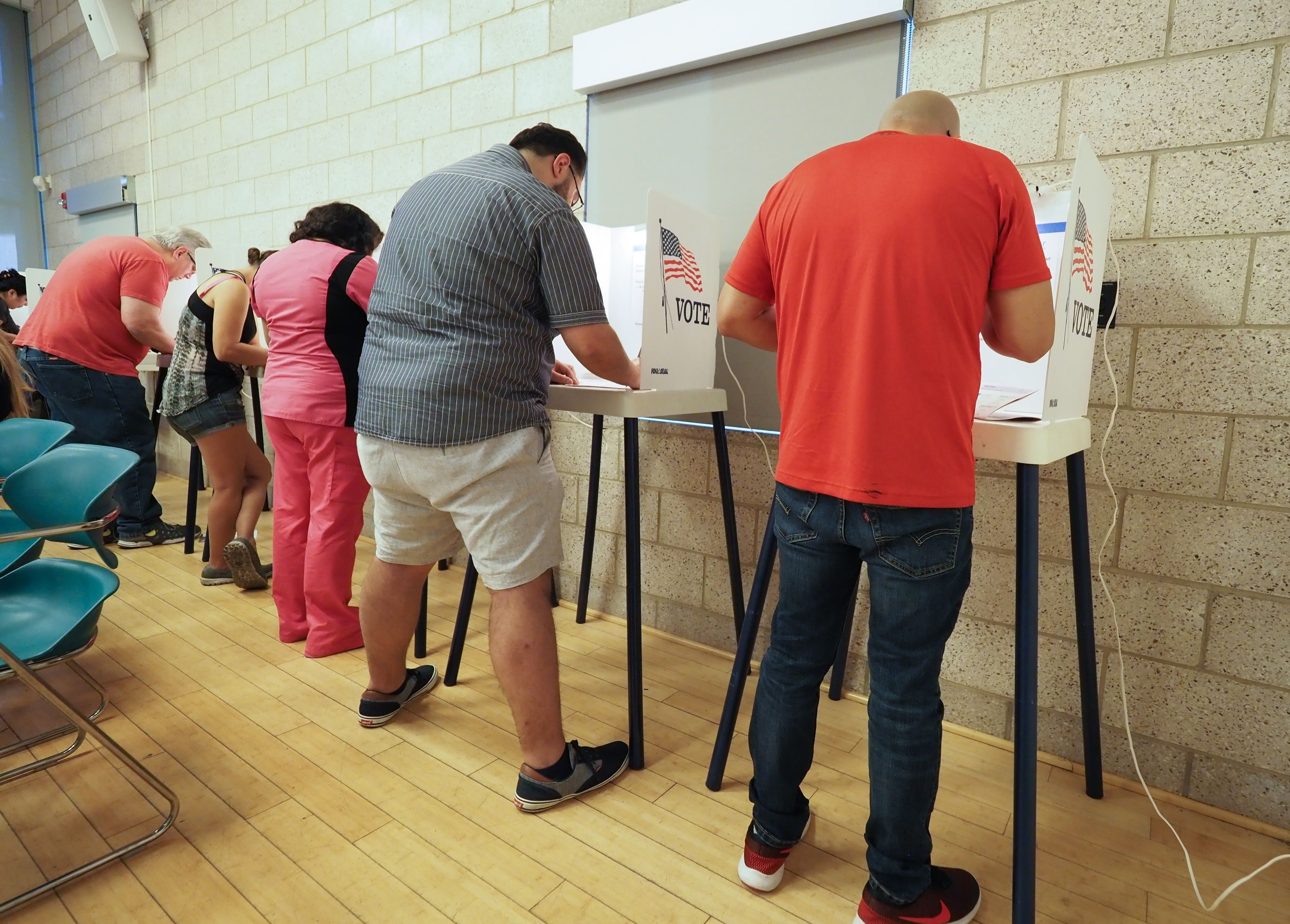 People cast their ballot during early voting for the midterm elections in the Lake View Terrace neighborhood of Los Angeles, California.