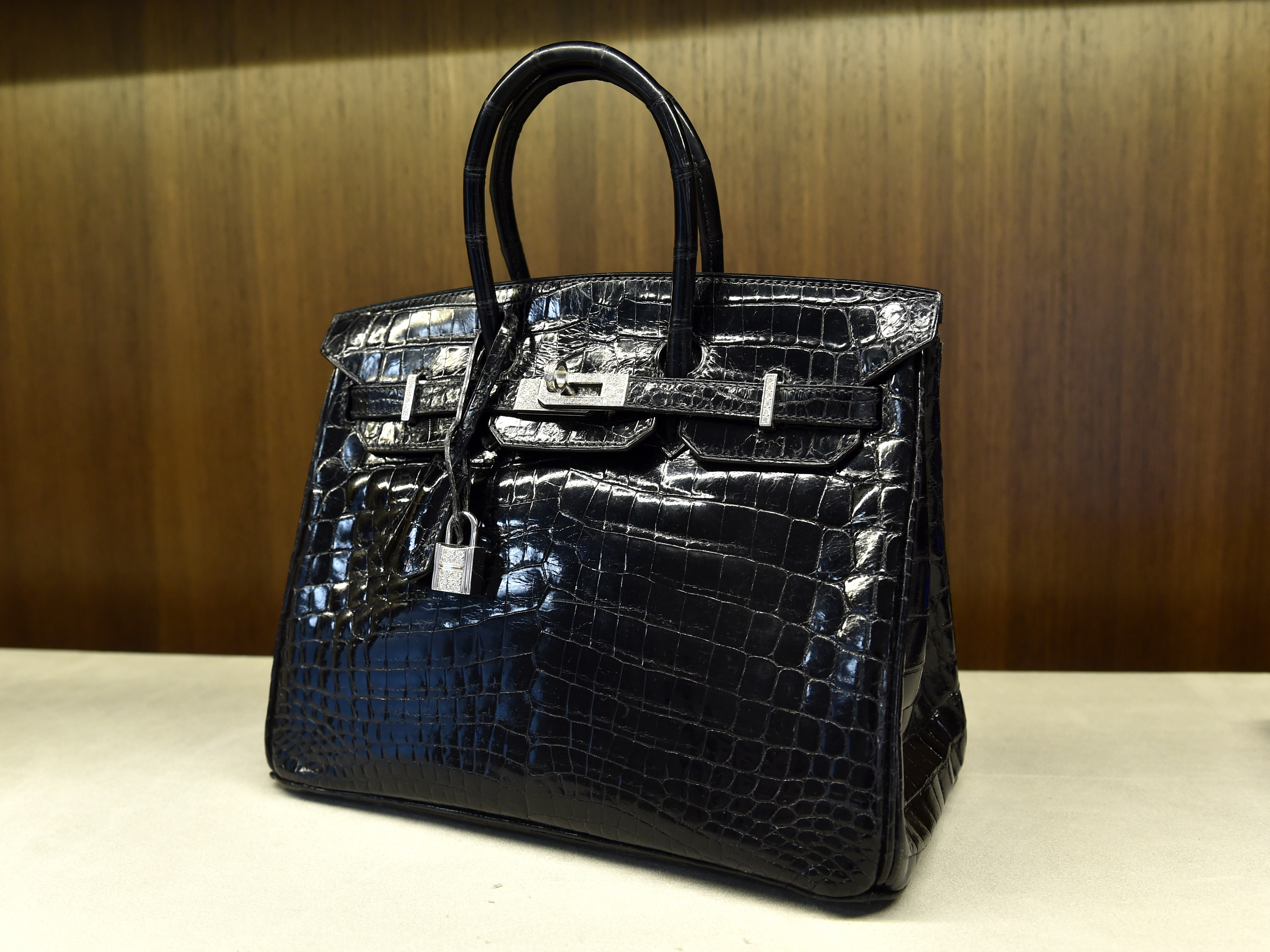 A shiny black crocodile Birkin bag is displayed in New York in 2014. Michael Cohen's plea said he failed to report proceeds of a similar bag.