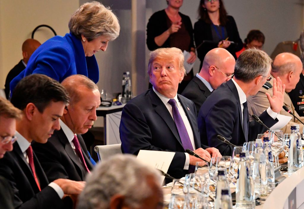 President Donald Trump looks at British Prime Minister Theresa May during a dinner of leaders at the Art and History Museum at the Park Cinquantenaire in Brussels on July 11, 2018.