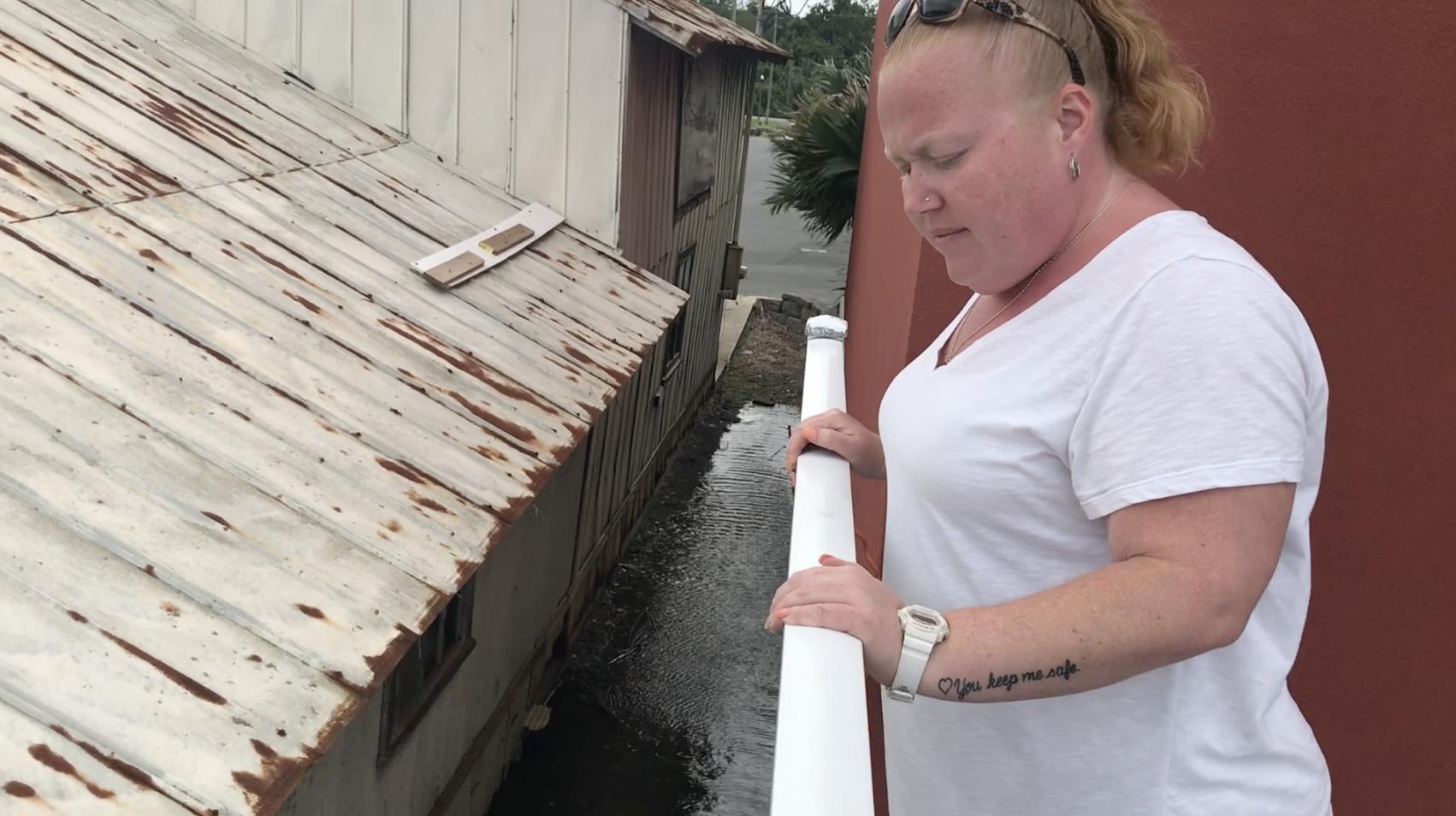 Hotel manager Christina Nabors monitors water levels at the Water Street Hotel & Marina in Apalachicola, Florida.