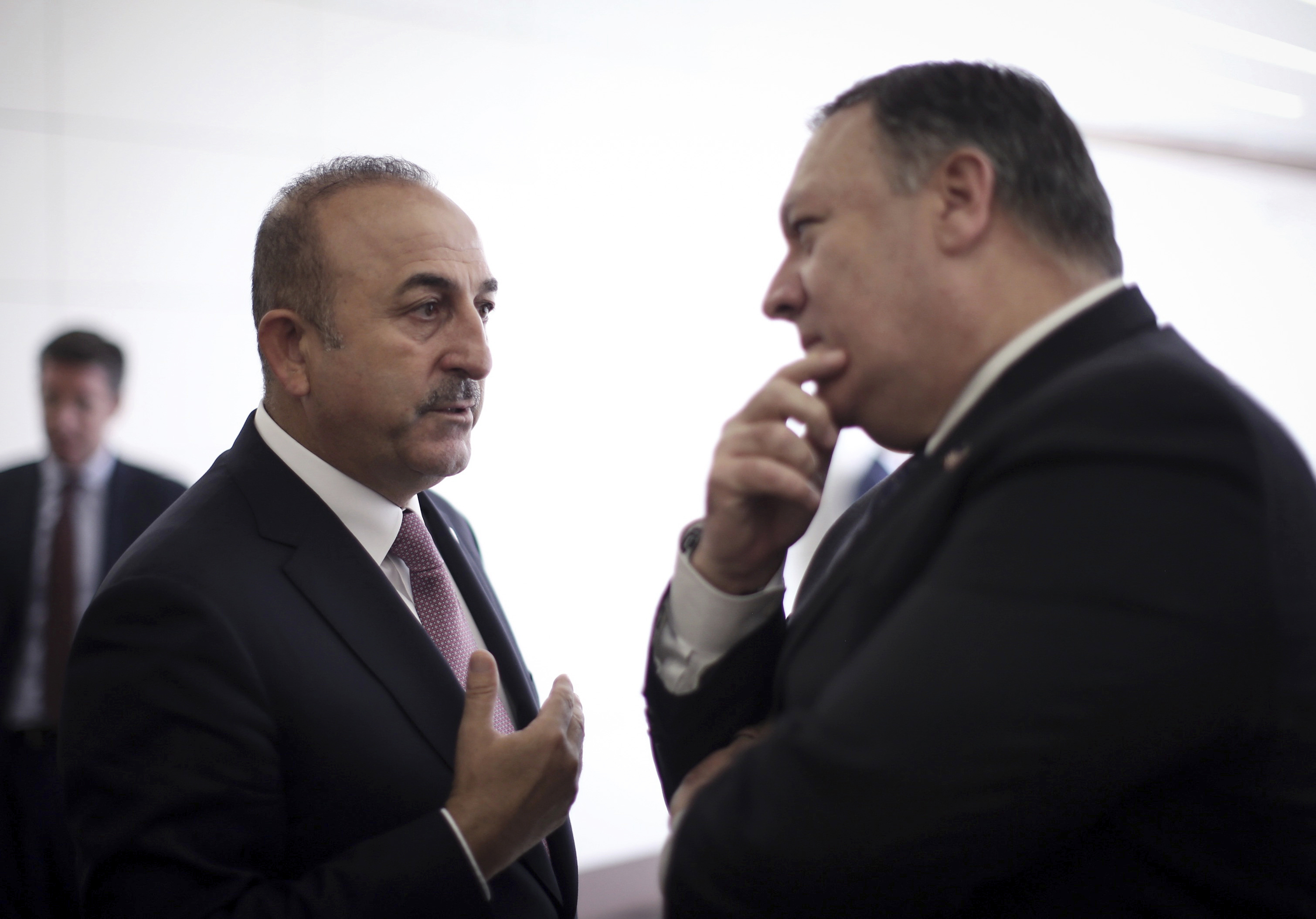 Turkish Foreign Minister Mevlut Cavusoglu, pictured left, talks with US Secretary of State Mike Pompeo in Ankara, Turkey, on Wednesday.