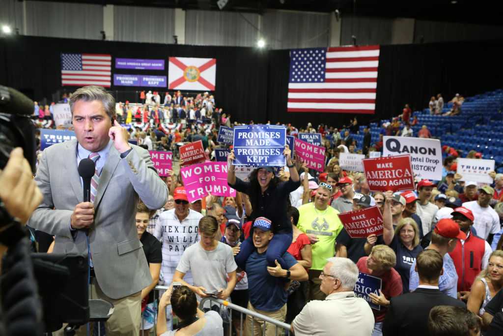 CNN reporter Jim Acosta is heckled by Trump supporters during a Make America Great Again rally Tuesday, July 31, 2018 at the Florida State Fair Grounds in Tampa, Florida.