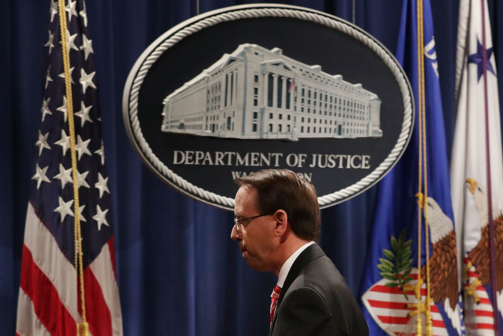 Deputy Attorney General Rod Rosenstein leaves a news conference at the Department of Justice on July 13 after announcing indictments against 12 Russian intelligence agents.