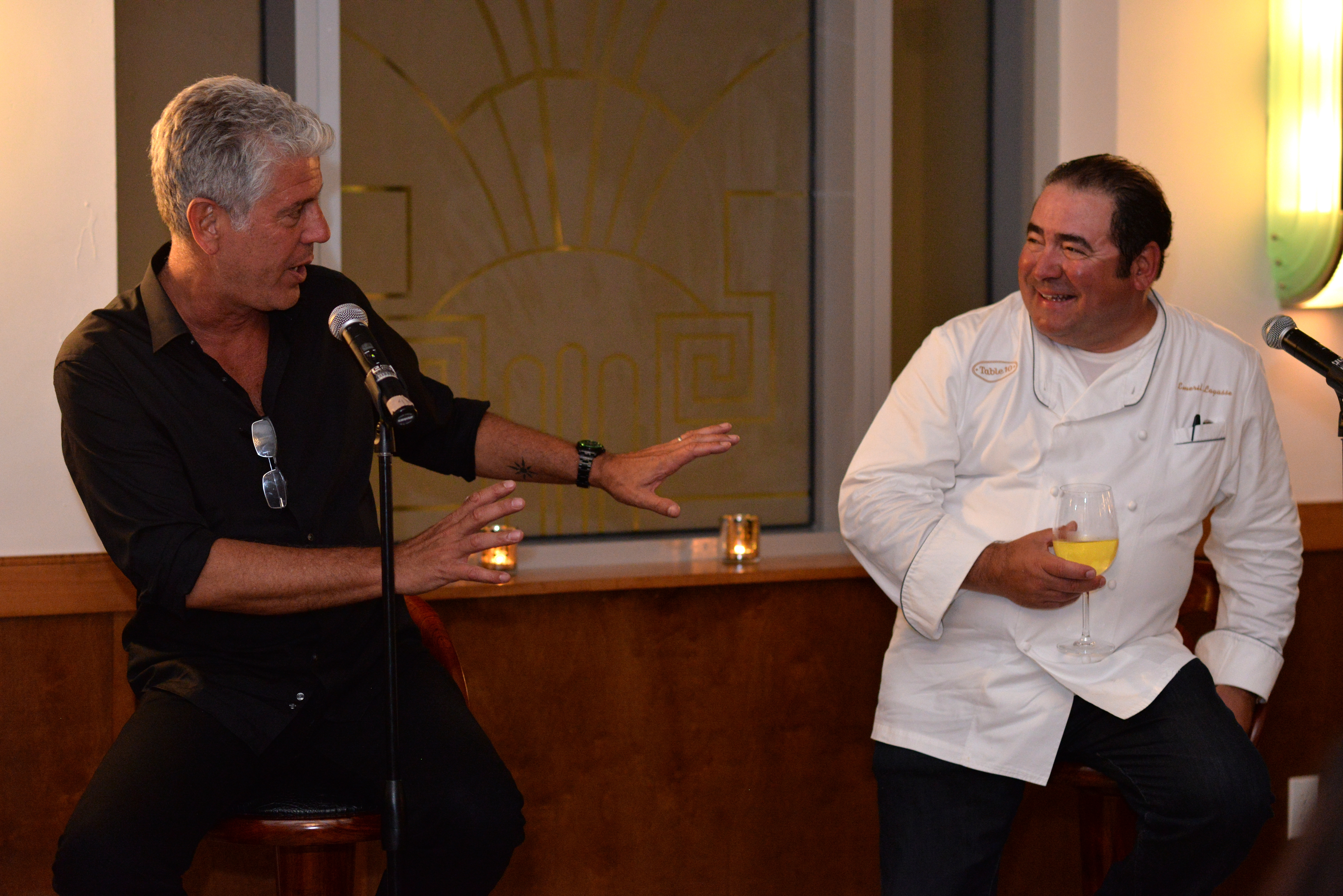Anthony Bourdain and Emeril Lagasse speak at the Food Network South Beach Wine & Food Festival in February 2014