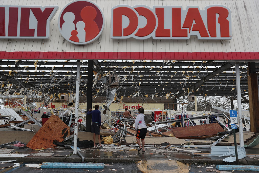 People look on at a store damaged by Hurricane Michael on Oct. 10, 2018 in Panama City, Florida.