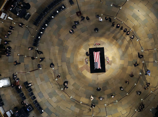Dignitaries pauses as they pay respects to Sen. John McCain, R-Ariz., who lies in state in the U.S. Capitol Rotunda on Aug. 31, 2018 in Washington.