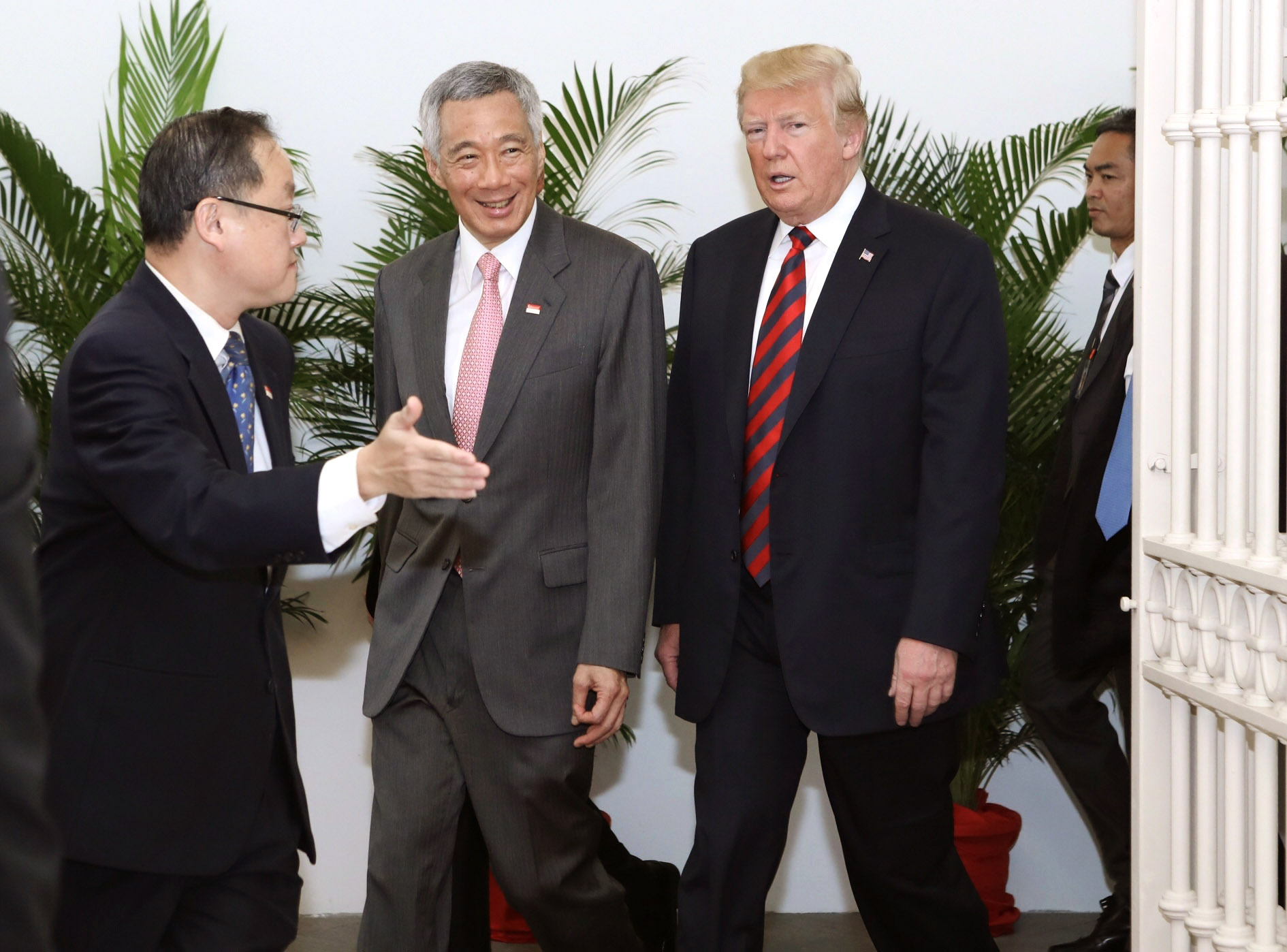This handout provided by the Singapore's Ministry of Communications and Information (MCI) shows Trump with Singapore's Prime Minister Lee Hsien Loong on June 11.