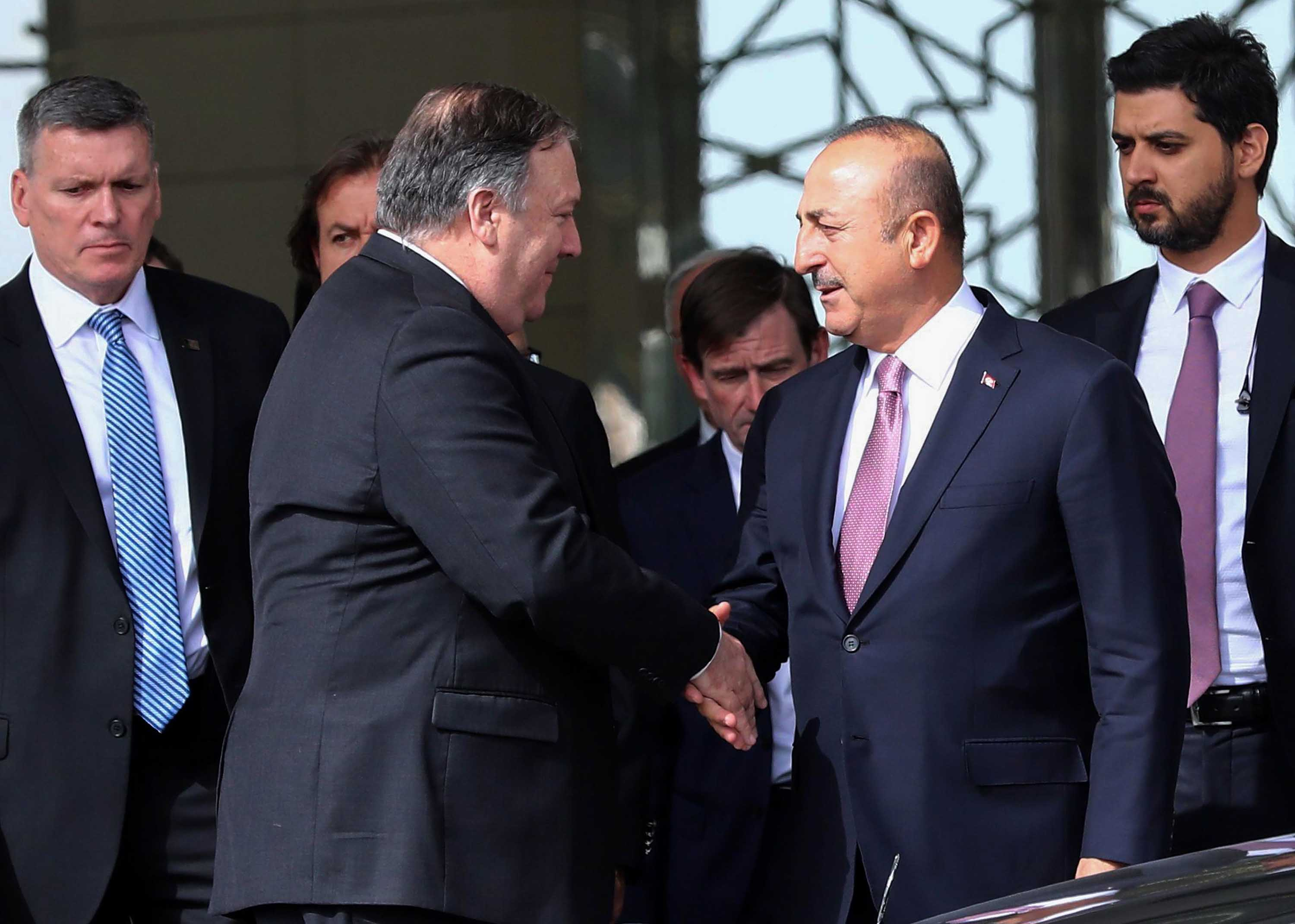 US Secretary of State Mike Pompeo and Turkish Foreign Minister MevluCavusoglu shake hands after their meeting at Ankara Esenboga Airport in Ankara, Turkey, on Wednesday.