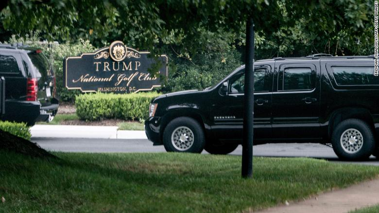 Armored vehicles arrive along with President Donald Trump at the Trump National Golf Club earlier today in Sterling, Virginia.