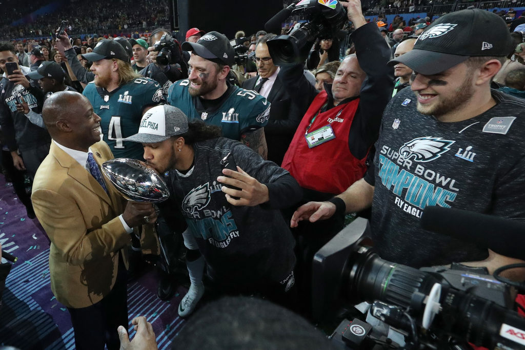 Hall of Famer Darrell Green carries the Lombardi trophy to the stage after the Philadelphia Eagles defeated the New England Patriots 41-33 in Super Bowl at US Bank Stadium on February 4, 2018 in Minneapolis, Minnesota.