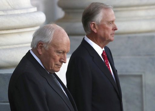 Former Vice President Dick Cheney, left, and and former Vice President Dan Quayle, await the arrival of the procession carrying the casket of former President George H. W. Bush at the Capitol on Dec. 3, 2018 in Washington.