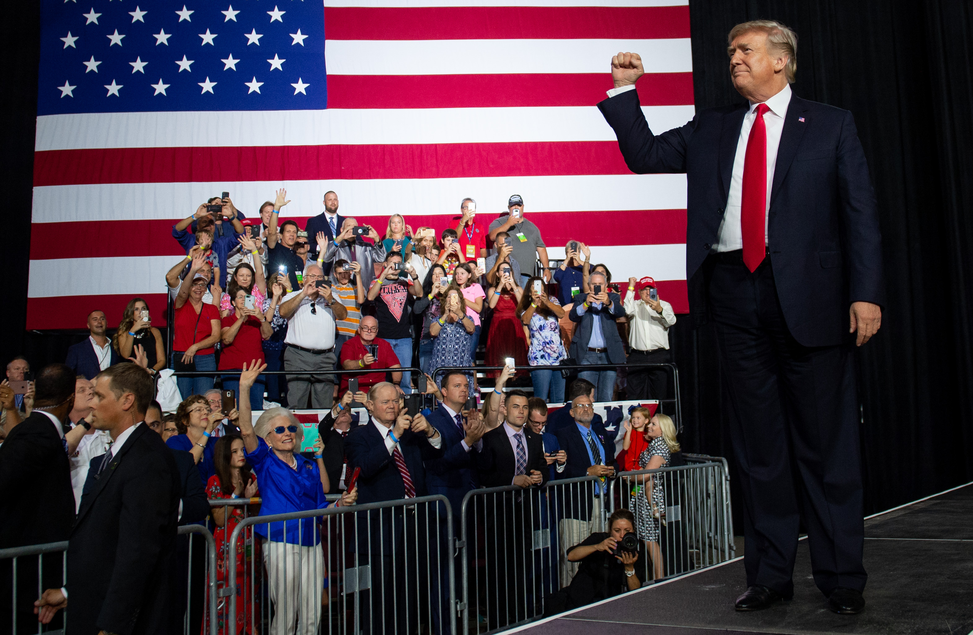 Trump greets the crowd during a campaign rally at the Florida State Fairgrounds Expo Hall in Tampa, Florida, on July 31