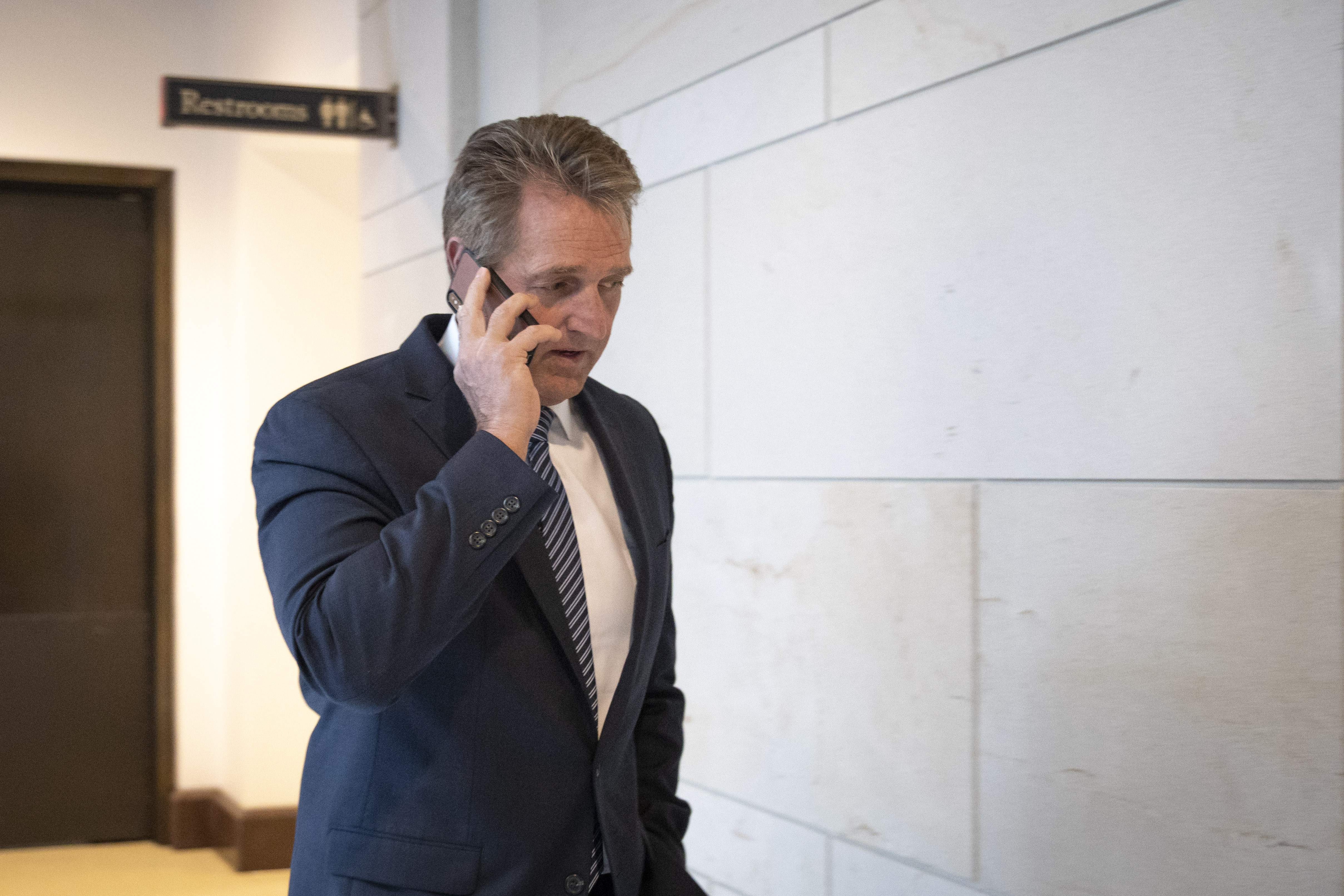 Sen. Jeff Flake arrives at the Office of Senate Security, which houses a 'sensitive compartmented information facility,' or SCIF, where Senators are able to view the report about alleged sexual assaults by Supreme Court nominee Judge Brett Kavanaugh.