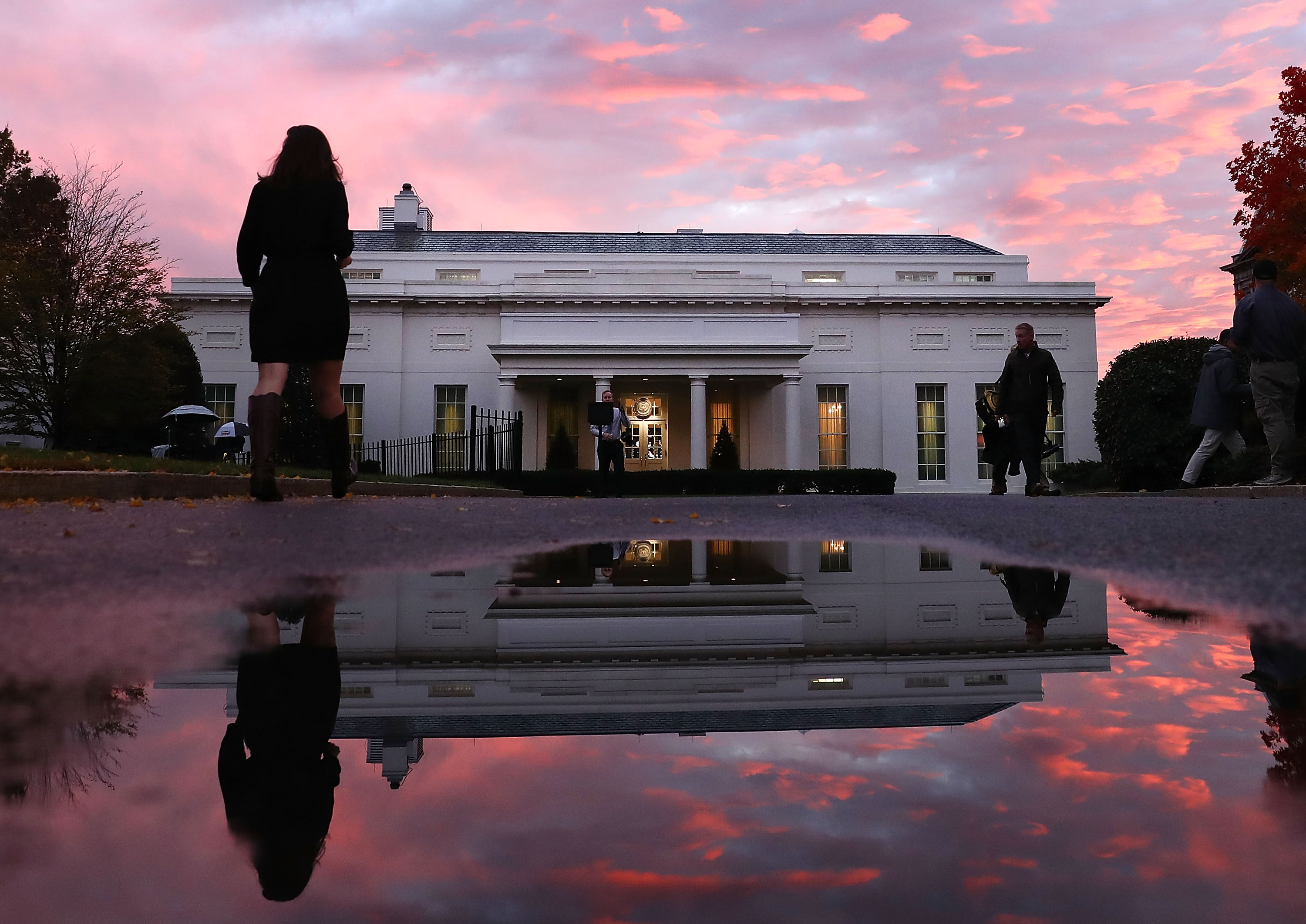 The sun sets behind the West Wing of the White House on Election Day.
