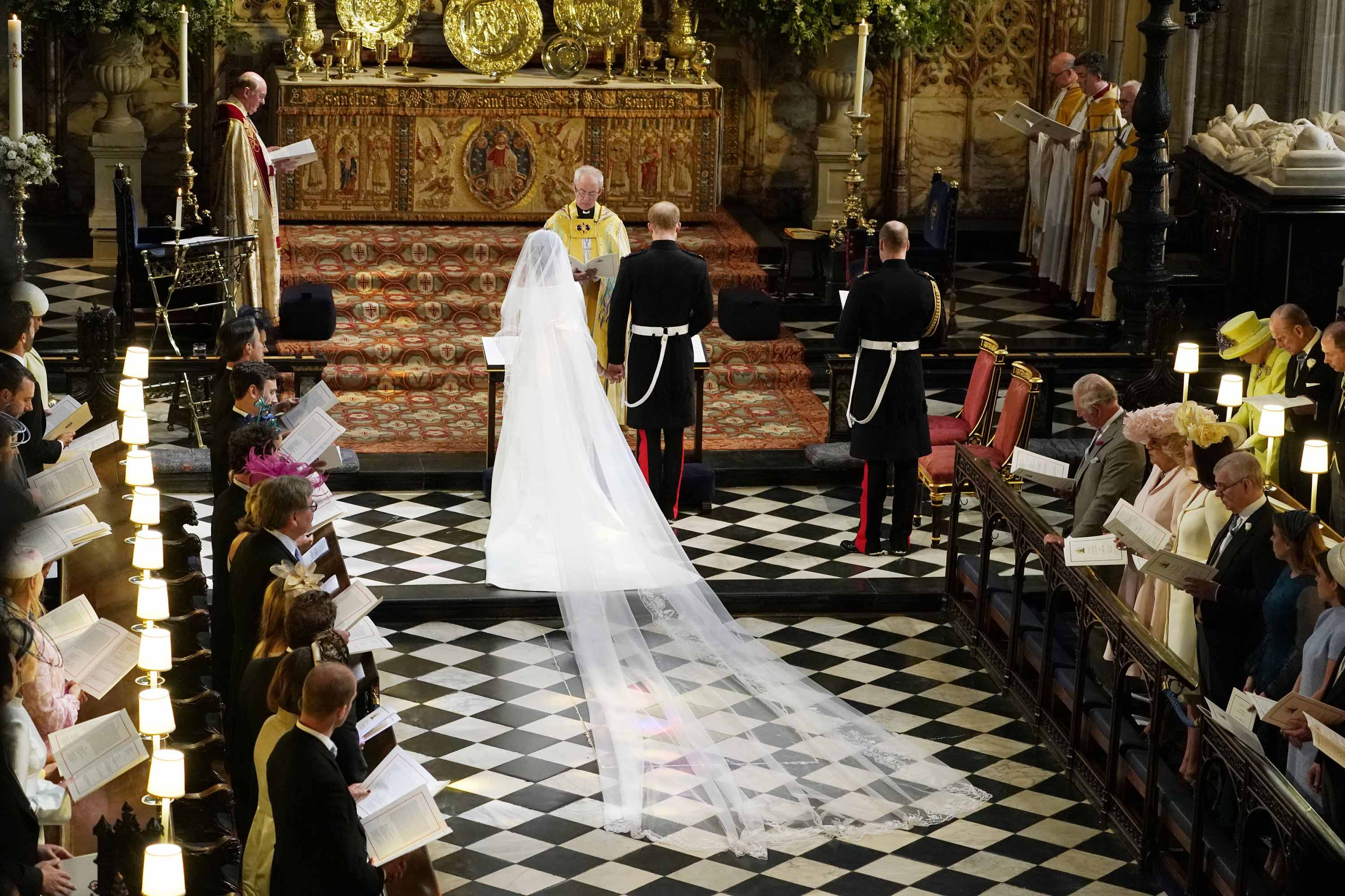 Prince Harry and Meghan Markle in St. George's Chapel at Windsor Castle during their wedding service, conducted by the Archbishop of Canterbury Justin Welby.