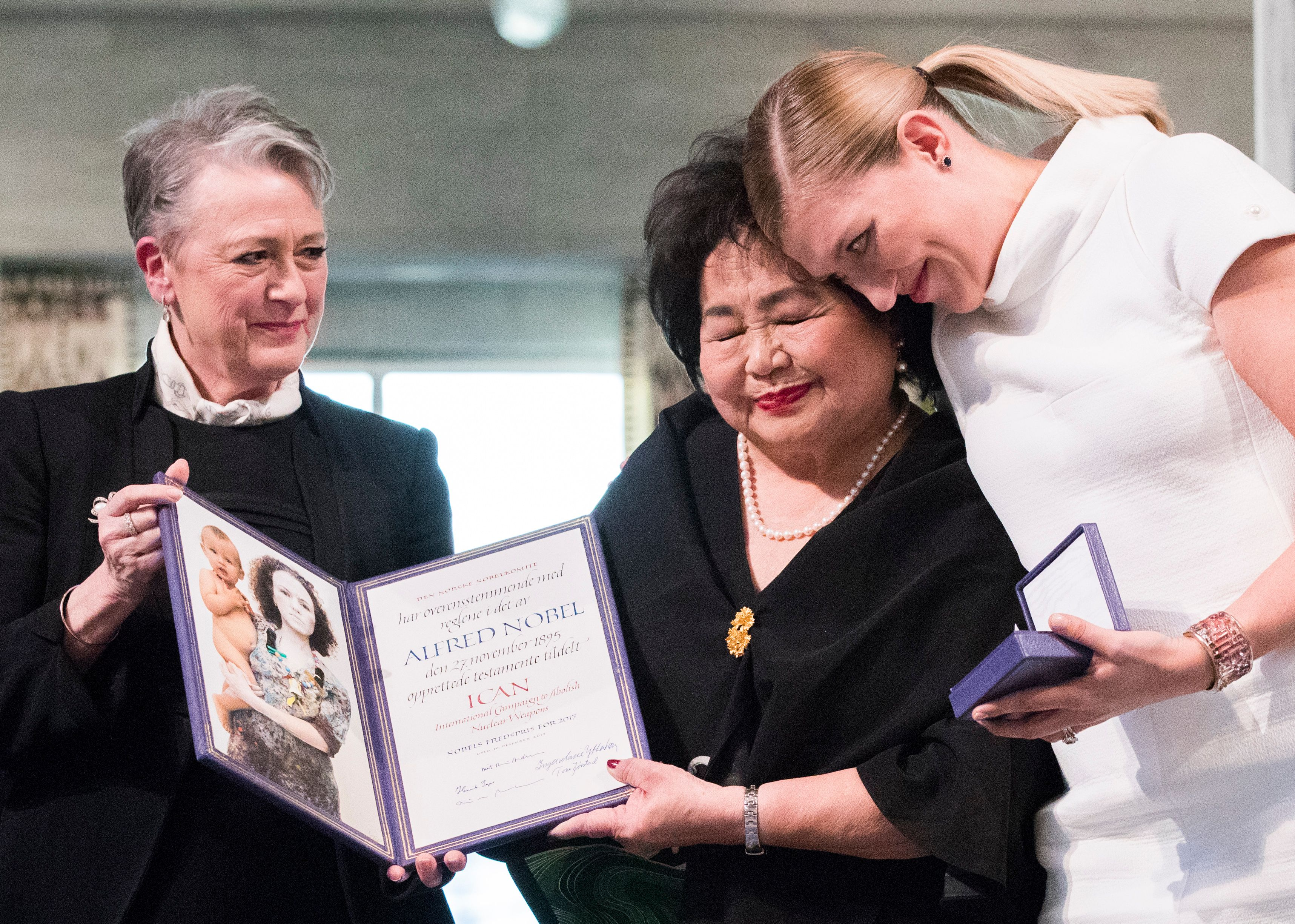 Beatrice Fihn, pictured right, leader of the International Campaign to Abolish Nuclear Weapons, and Hiroshima nuclear bombing survivor Setsuko Thurlow, pictured center, during the award ceremony for the 2017 Nobel Peace Prize on December 10, 2017.