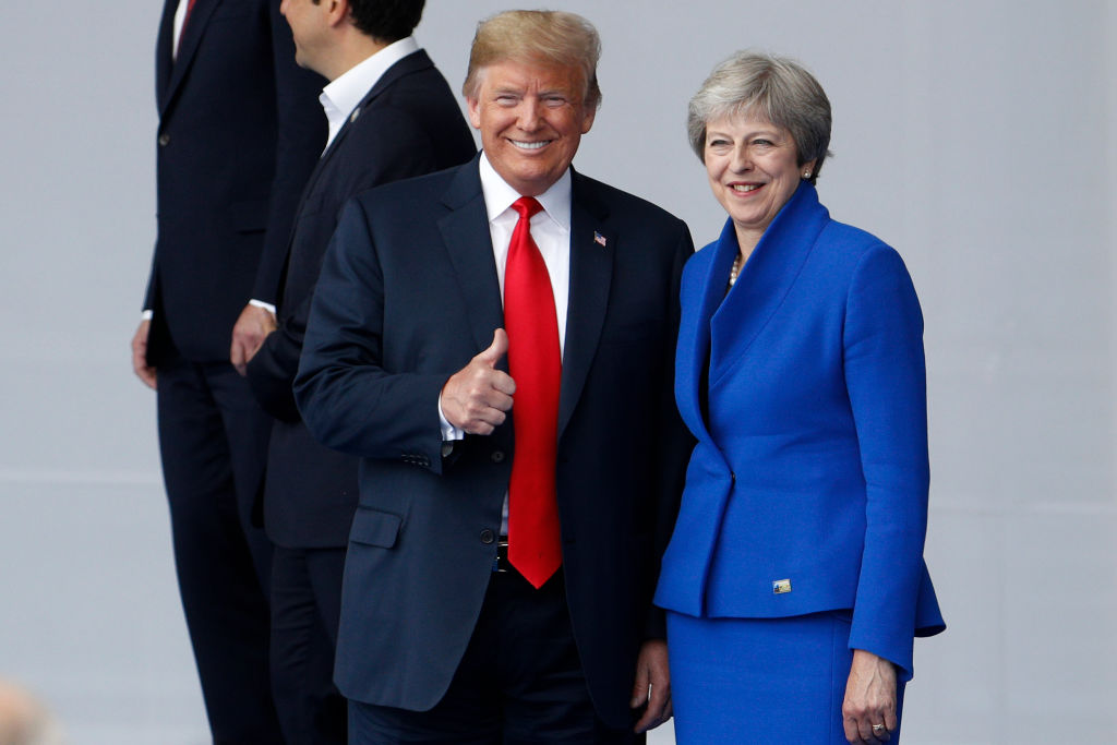 US President Donald Trump (L) poses with Britain's Prime Minister Theresa May during a family photo ahead of the opening ceremony of the NATO in Brussels, on July 11, 2018.