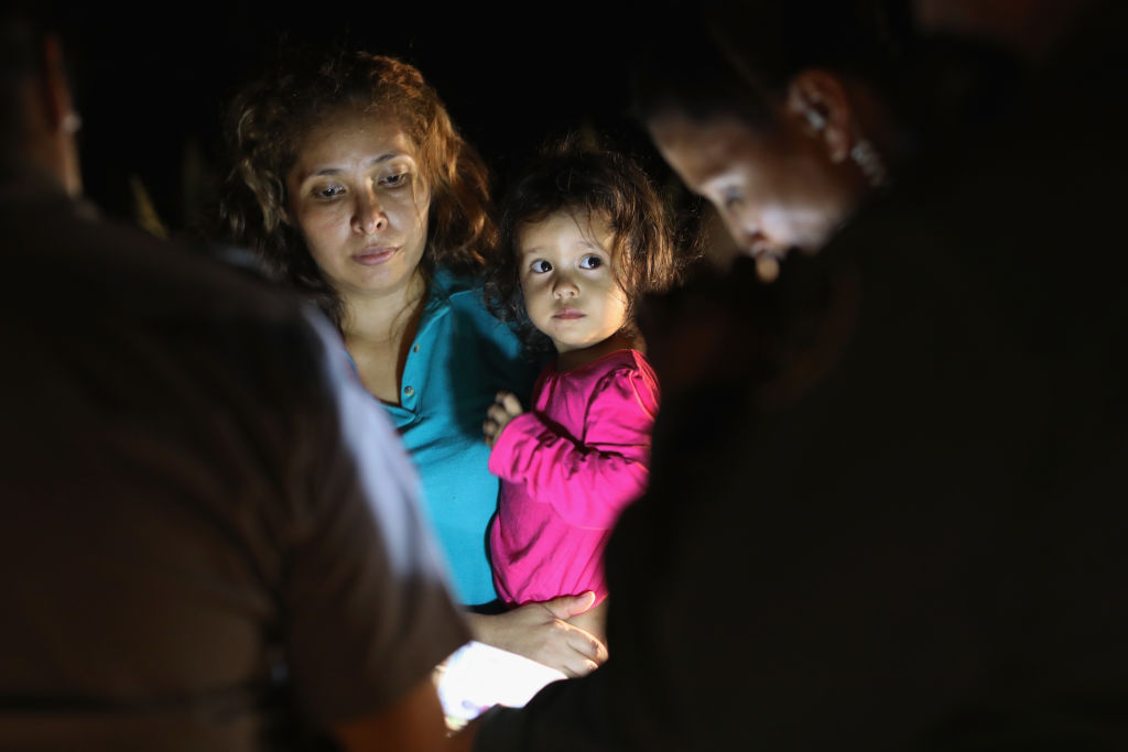 Central American asylum seekers, including a Honduran girl, 2, and her mother, are taken into custody near the US-Mexico border on June 12, 2018 in McAllen, Texas.