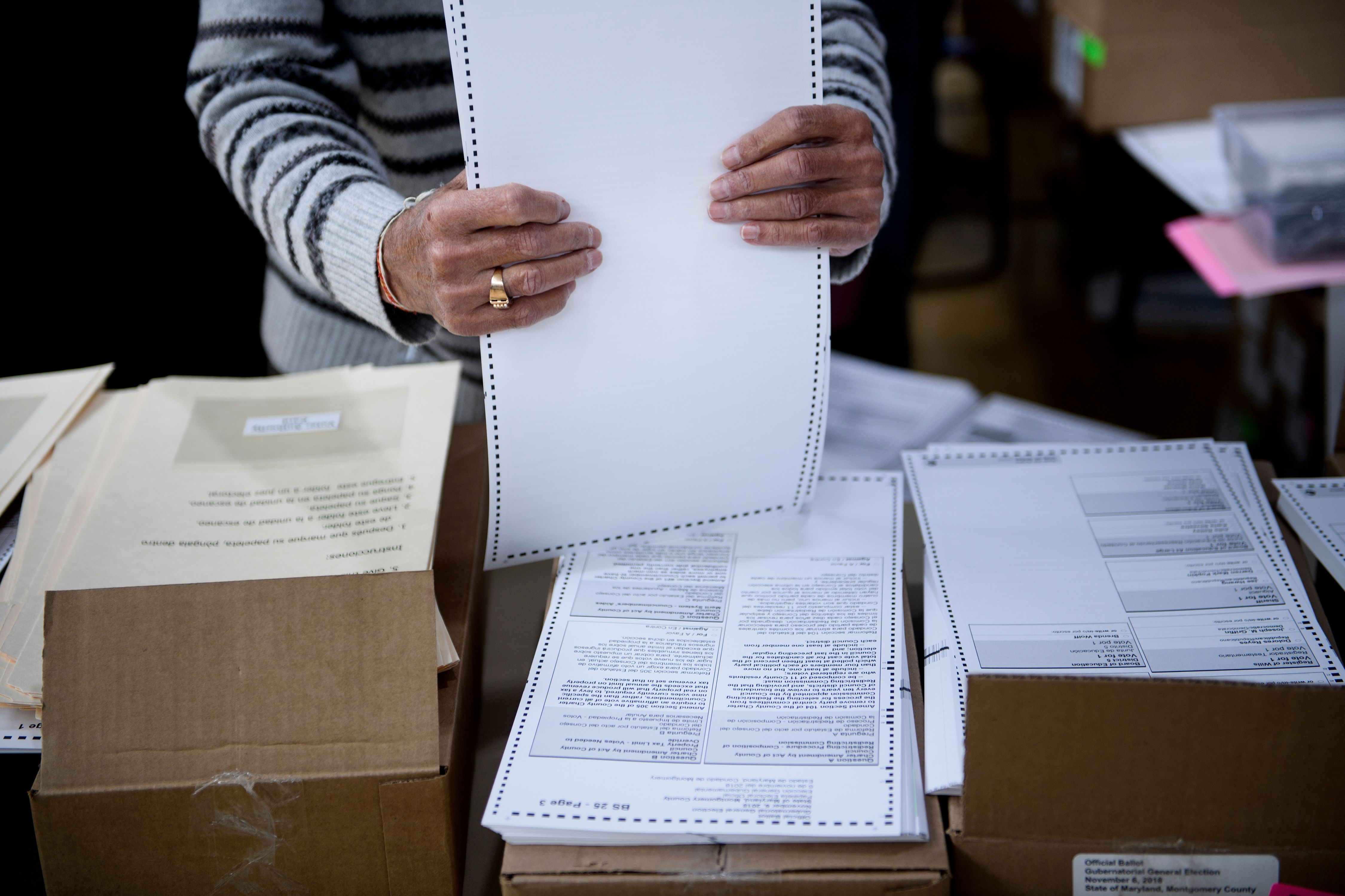 A man prepares ballots on Oct. 25 during early voting in Potomac, Maryland.