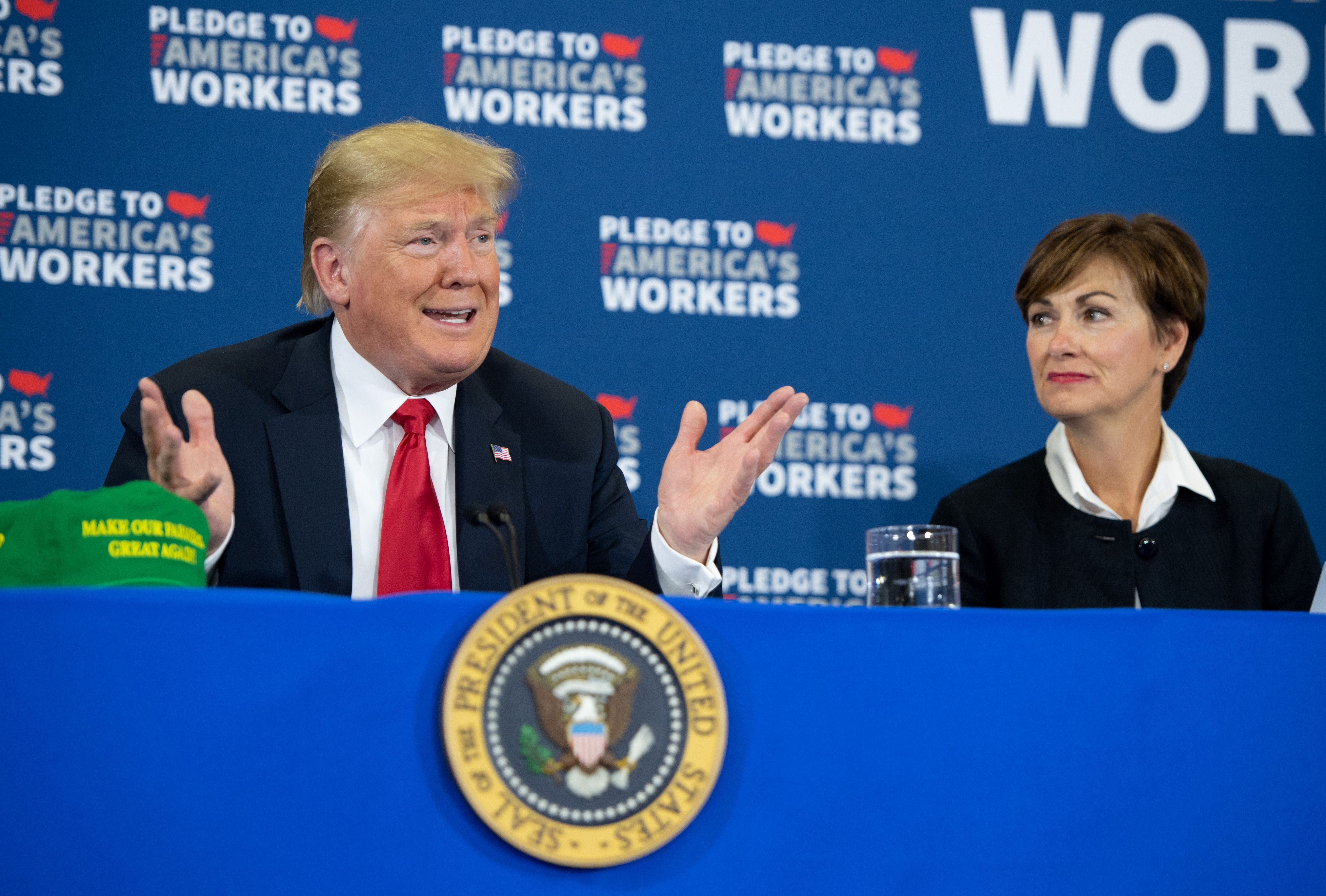 President Donald Trump speaks, alongside Iowa Governor Kim Reynolds (R), as he holds a roundtable discussion on workforce development at Northeast Iowa Community College in Peosta, Iowa, July 26, 2018.