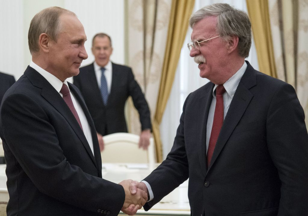Russian President Vladimir Putin (L) shakes hands with US national security adviser John Bolton during their meeting in the Kremlin in Moscow, on June 27, 2018.