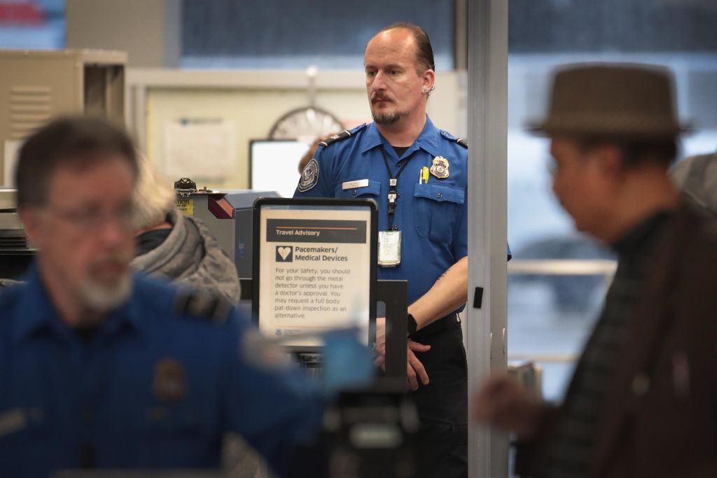 A Transportation Security Administration worker screens passengers and airport employees at O'Hare International Airport on Jan. 07, 2019 in Chicago, Illinois.