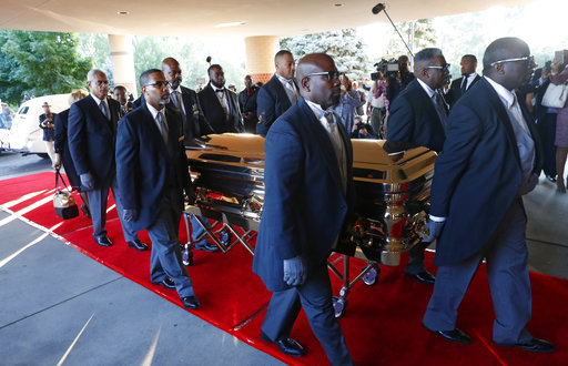 Pallbearers carry the gold casket of legendary singer Aretha Franklin after arriving at the Greater Grace Temple in Detroit, Friday, Aug. 31, 2018.