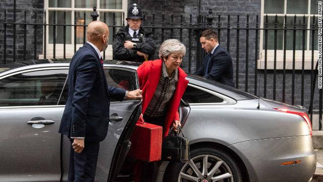 Theresa May arrives back at Downing Street after her radio interview this morning