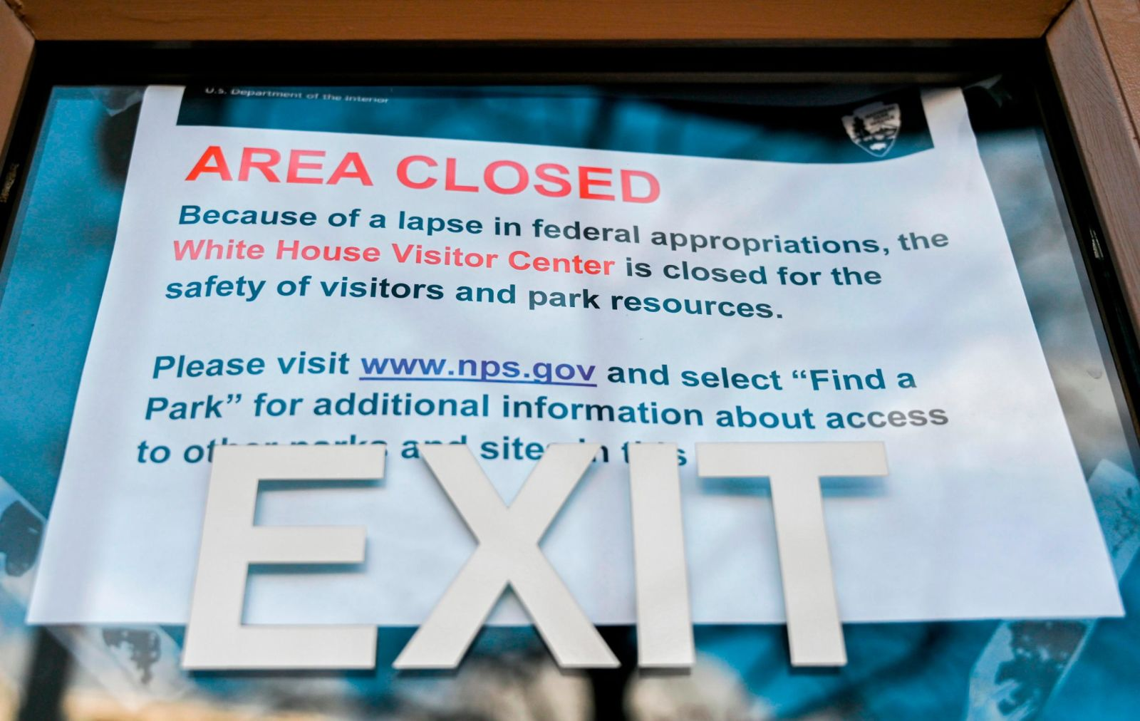 A sign is displayed outside of a US government building December 22. The partial government shutdown is set to stretch through Christmas as the Senate adjourned Saturday without a deal.