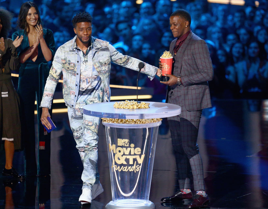 James Shaw Jr. (R) accepts the Best Hero award presented to him by 'Black Panther' actor Chadwick Boseman (L) onstage during the 2018 MTV Movie And TV Awards.