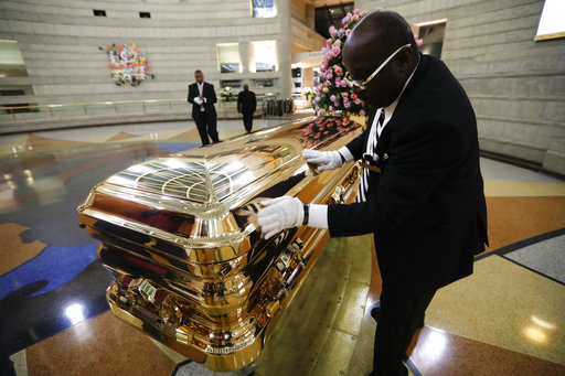 Vincent Street wipes down the casket of legendary singer Aretha Franklin at the Charles H. Wright Museum of African American History in Detroit on Aug. 29, 2018.