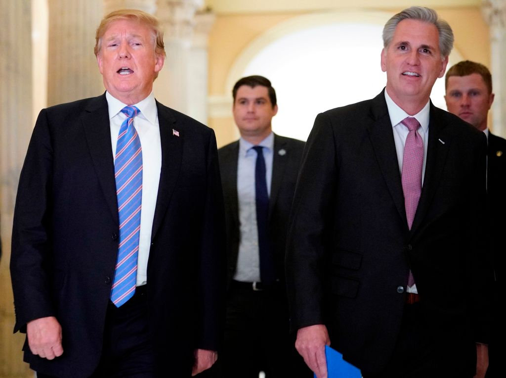 President Donald Trump (L) walks next to US House Majority Leader Kevin McCarthy (R-CA) after a meeting at the US Capitol with the House Republican Conference in Washington, DC on June 19, 2018.