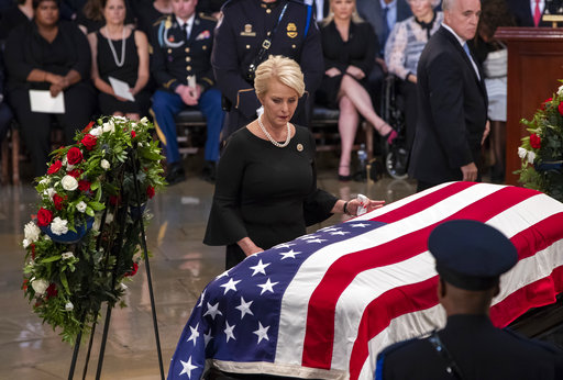 Cindy McCain, wife of Sen. John McCain, R-Ariz., touches his flag-draped casket during a farewell ceremony in the U.S. Capitol rotunda on Aug. 31, 2018 in Washington.