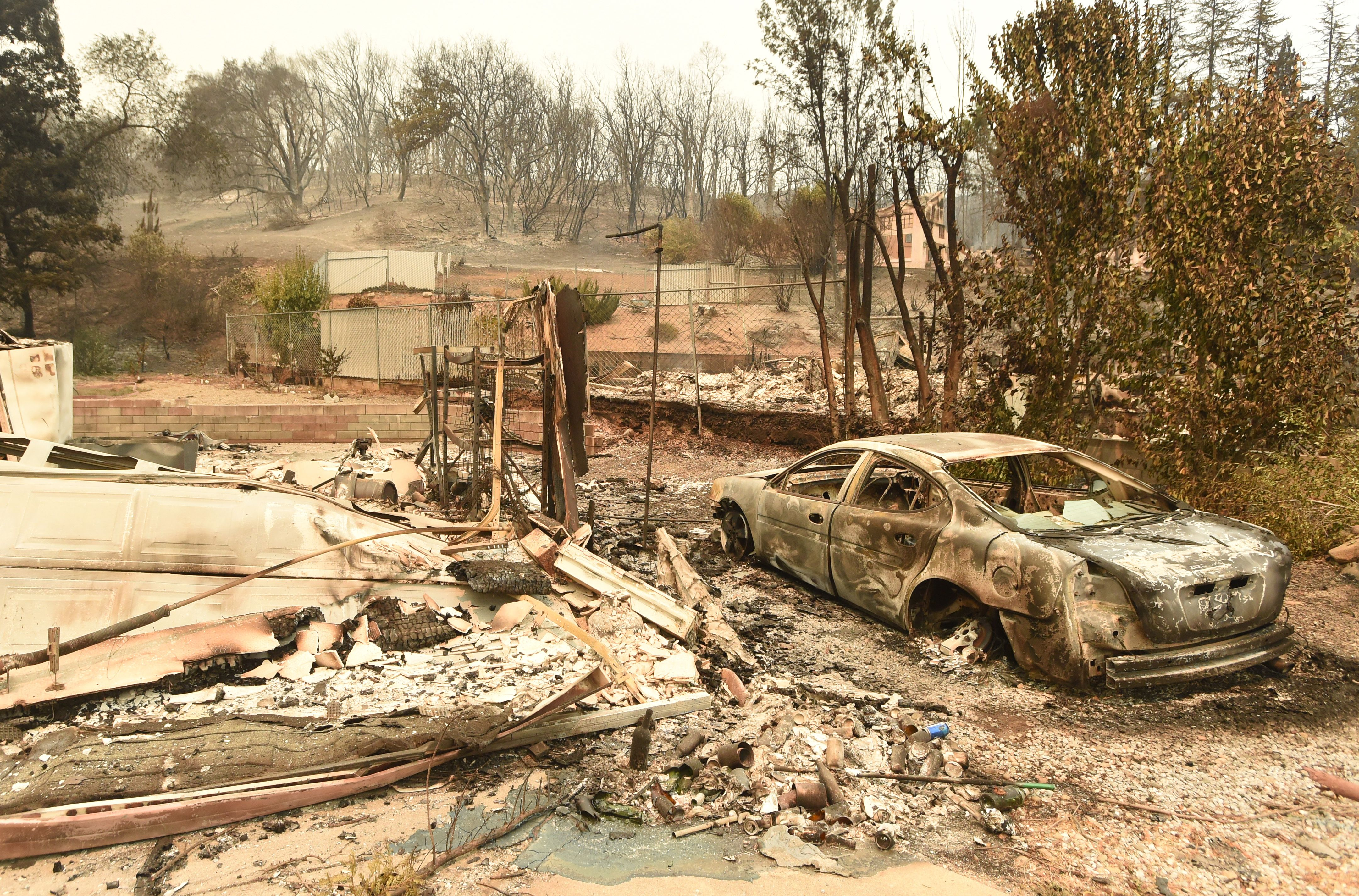 The burned out remains of a home in a residential neighborhood during the Carr Fire in Redding, California on July 27, 2018.