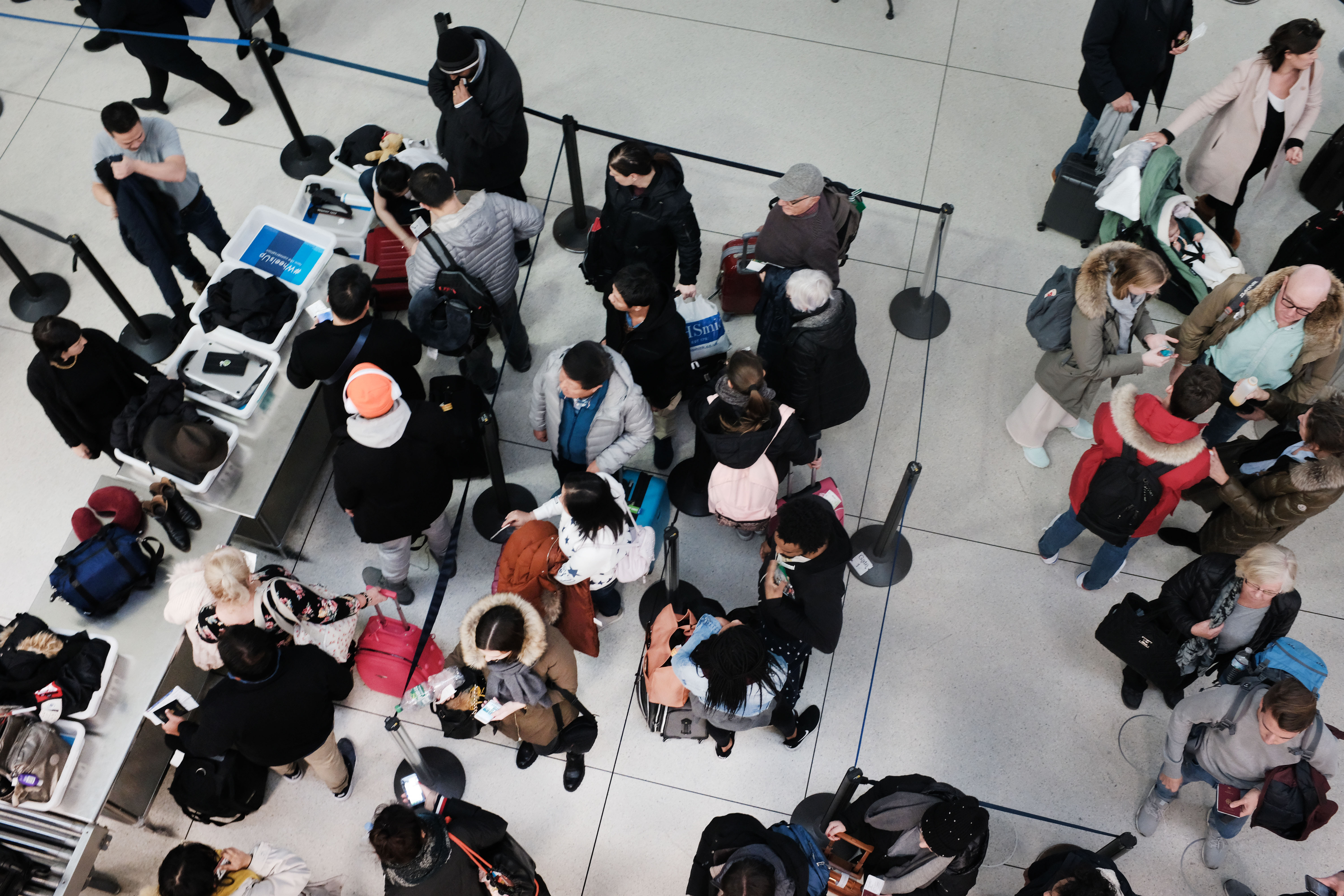 Passengers wait in a TSA line at JFK airport on Wednesday in New York City.