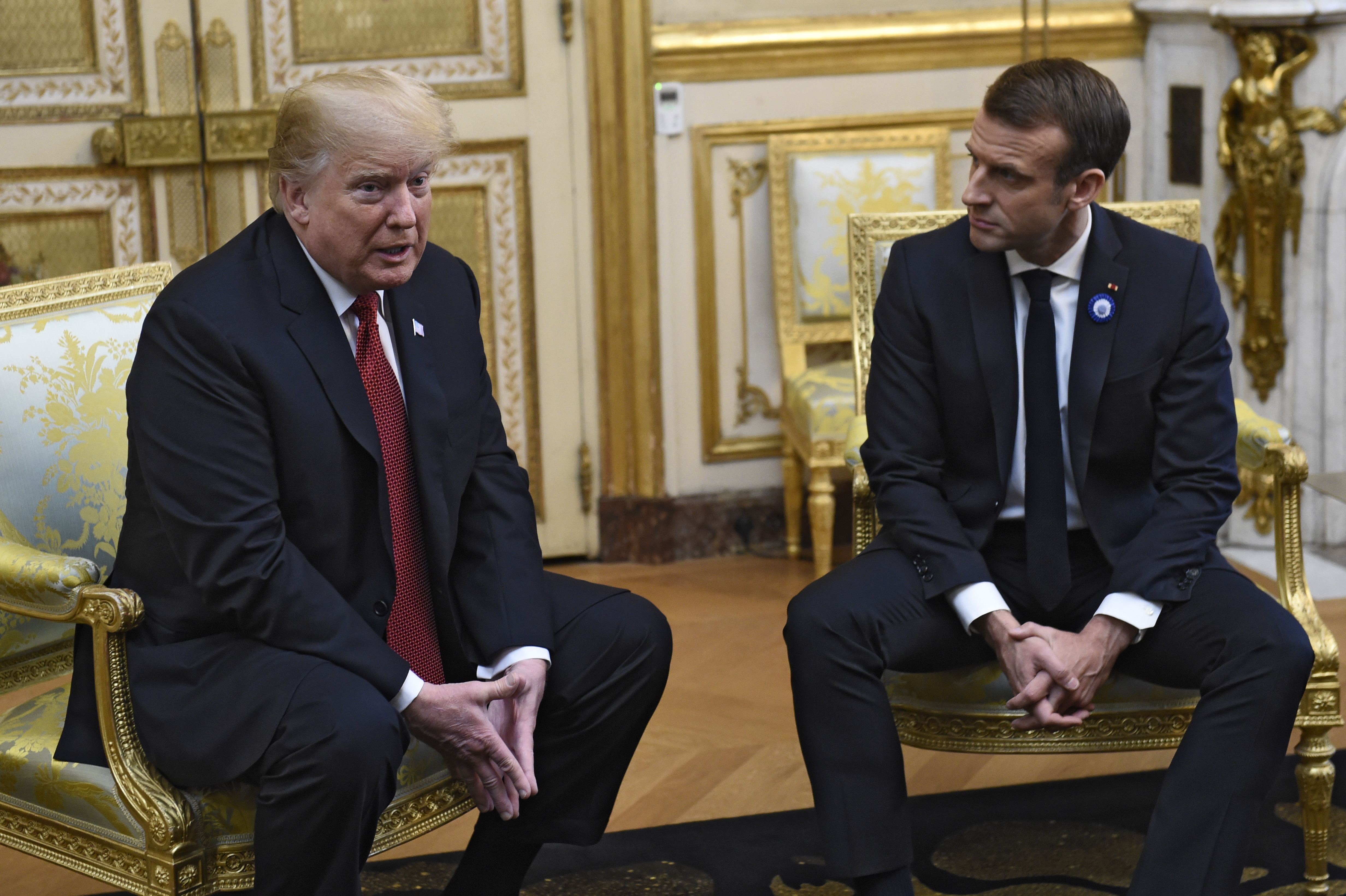 US President Donald Trump and French President Emmanuel Macron speak at the Elysee Palace ahead of bilateral talks.